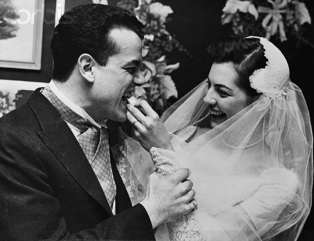 Rosemary Meyer Feeding Wedding Cake to Her Husband